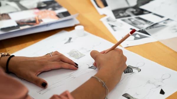 Student sketching designs