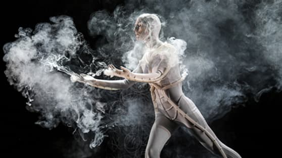 Photo of a man in a body suit surrounded by smoke