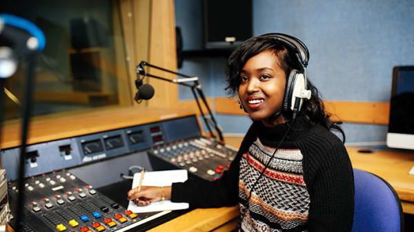 A journalism student working in one of the audio studios.