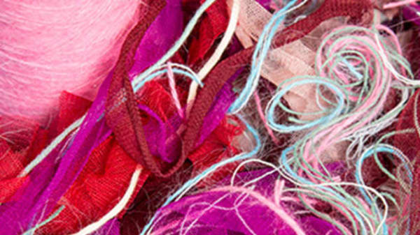 A closeup of pink fabrics and materials