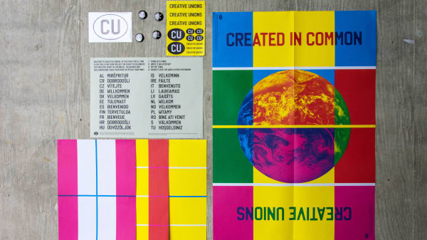 A number of Creative Unions posters laid out on the ground