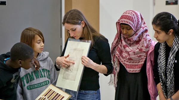 Judy Willcocks, Head of the Museum and Study Collection at Central Saint Martins, showing students a paper archive