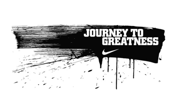 The text 'journey to greatness' and the nike tick logo is printed in white on a smear of black paint on a white background..