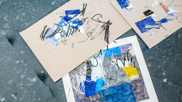 Pieces of paper with drawings and paintings on