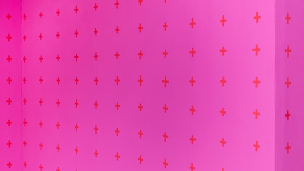 pink background with crosses