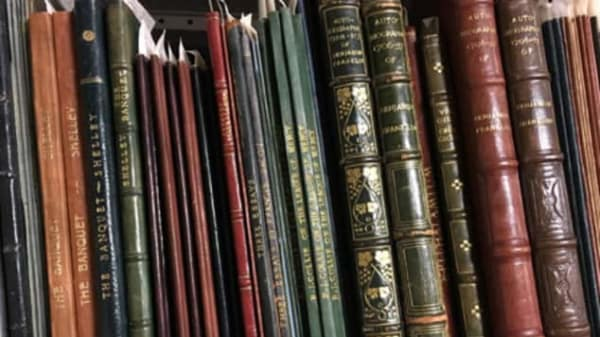 a selection of leather bound books
