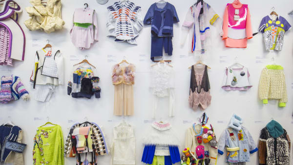 Fashion and textiles work hanging on a white wall