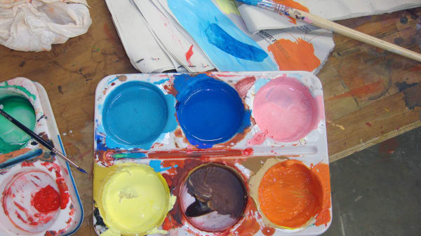 A paint tray filled with several colours