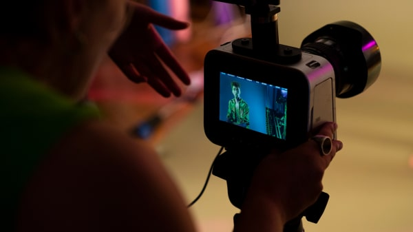 Student looking through camera viewfinder
