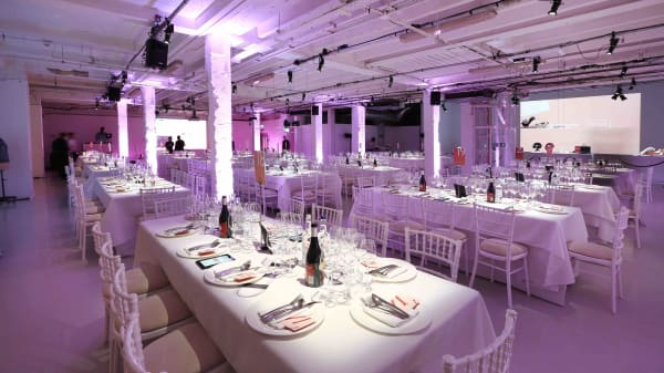LCF's Fashion Matters gala dinner and auction tables set for the evening in basement of Victoria House in Bloomsbury
