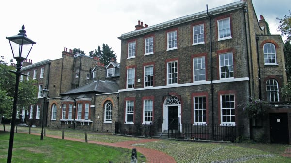 Photo of the exterior of Portland House and the lawn
