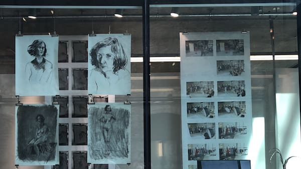 Portraits drawings hanging inside a Window Gallery