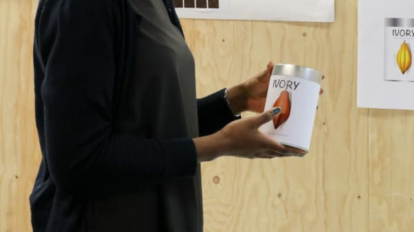 Student holding design product