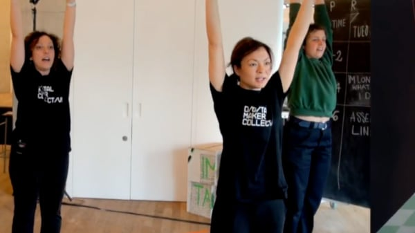Students raising their arms in the air to mimic the positioning of models shown on the right
