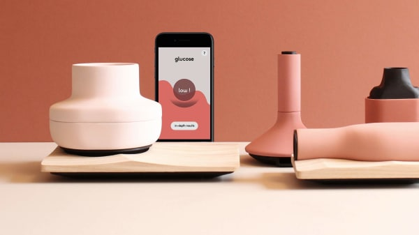 A series of pink objects on display on a table