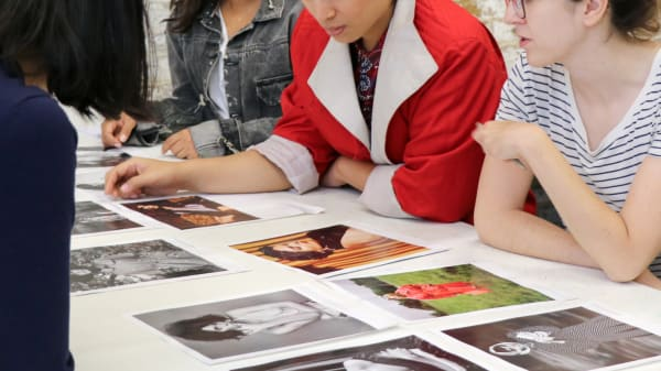 Art direction students looking at fashion photographs