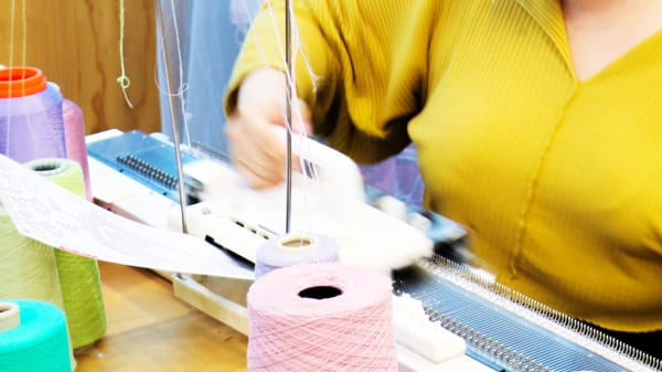 Student using knitting machine