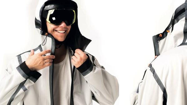 Male model in skiing googles with white sports jacket on