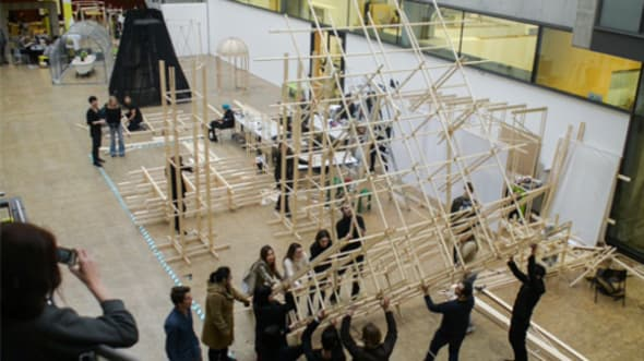 Students installing a wooden structure
