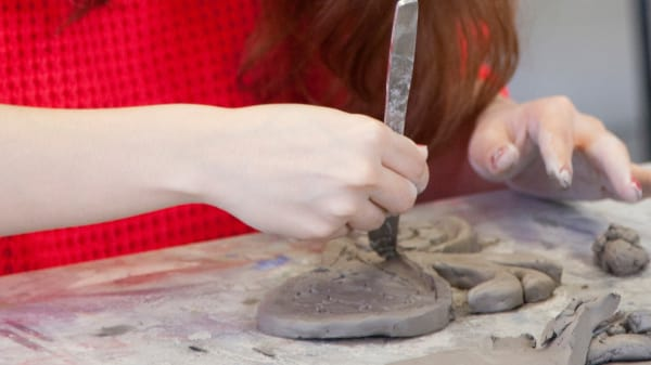 Student working on a ceramic model