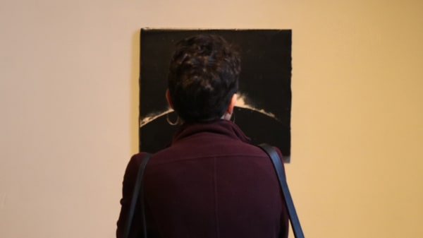 Student looking at art work