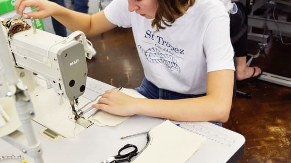 Proffesional Sewing Techniques student using sewing machine