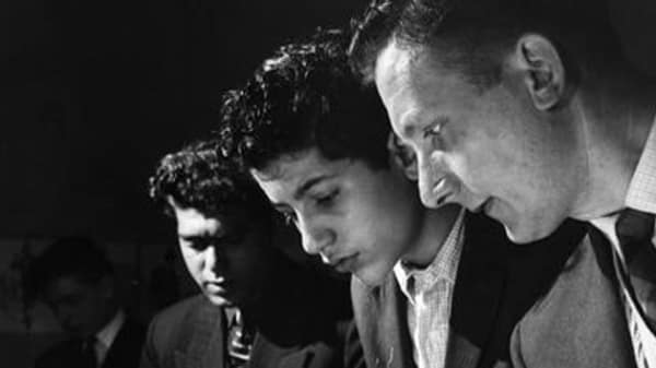 Black and white photo of side profile of three men