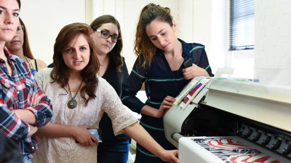 Group of students next to a printing machine