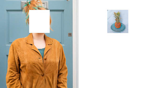 Photograph by artist Lorenza Demata showing a figure with orange hair and an orange jacket whose face is obscured by a white box.
