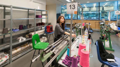 A person using a large knitting machine
