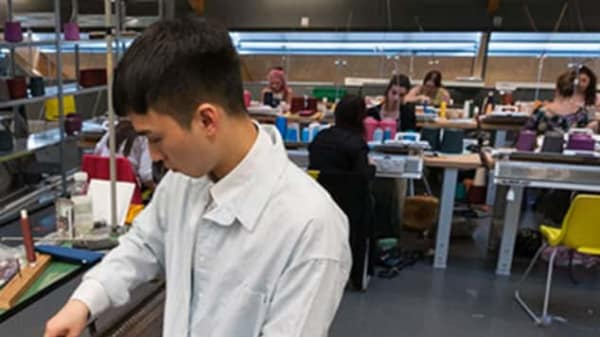A student working in the knit workshop