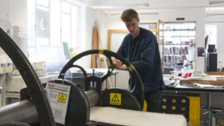 A person using a printing press