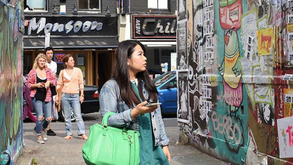 Woman walking through London street