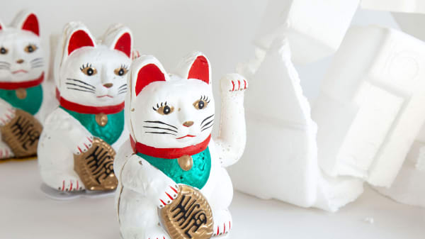 A row of lucky waving cats