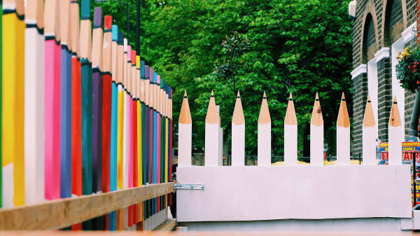 Large wooden pencil sculptures outdoors