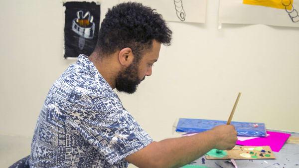 Student painting on cardboard