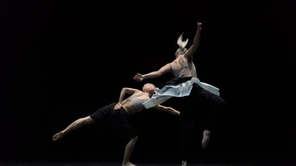 Two people dancing on a stage