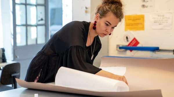 Pattern Cutting Student marking out pattern on paper