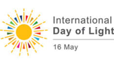 White background with a sun graphic and the words 'international day of light, 18 May' printed on it