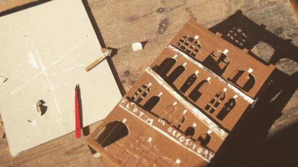 Photo of a cardboard model of a building lying on a table