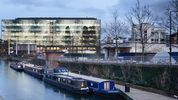 A large glass building opposite Regent's Canal