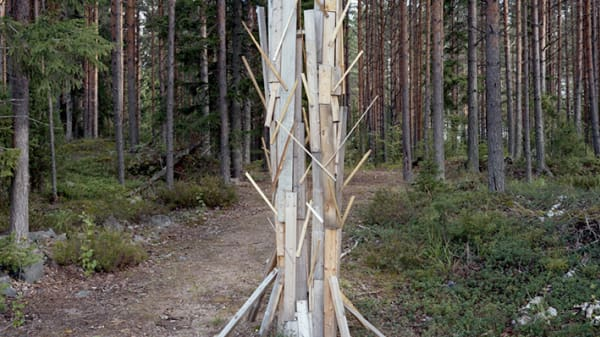 An installation by Minna Pöllänen situated within a clearing in the woods.