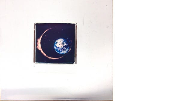 A small square image of an eclipse with a white border