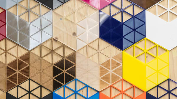 Close up shot of colourful hexagonal shapes on a board