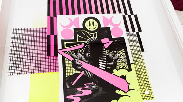 Close up image of a pink, yellow and black art work