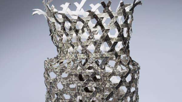 A sculptural silver vase
