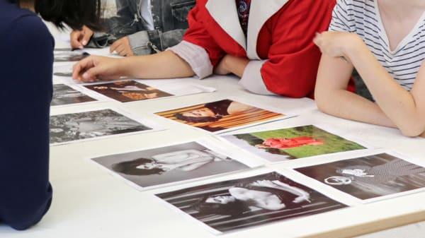 Students looking at fashion photographs
