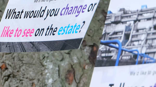 """Photo of flyer pinned to a tree saying """"What would you change or like to see on the estate?"""""""