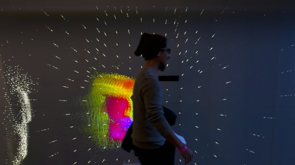 Image of a person walking past a projection mapping installation at London College of Communication