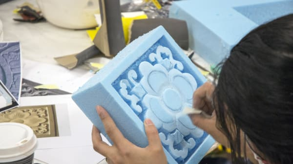 student working on a mould for a prop